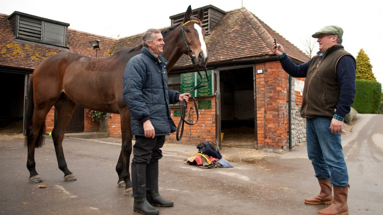 Paul Nicholls takes a picture of Kauto Star and Clifford Baker