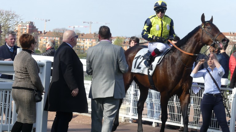 Alexis Badel and Surrey Thunder are welcomed back to the Saint-Cloud enclosure by members of the Surrey Racing Club