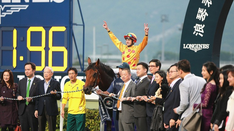 Doug Whyte, aboard Akeed Mofeed, celebrates victory in the Hong Kong Cup in 2013