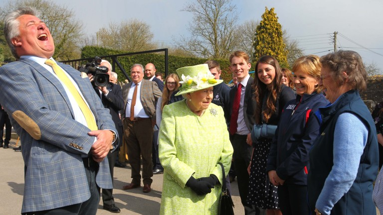 The Queen jokes with Ditcheat team members during her visit, including Bryony Frost (third right)