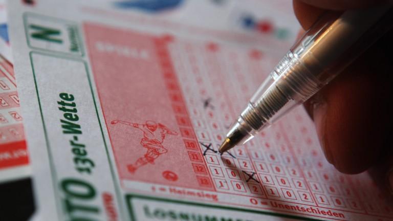 A punter fills out a football betting slip