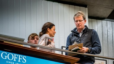 David Redvers, with assistant Hannah Wall, signs the docket for the Kingman colt at Goffs