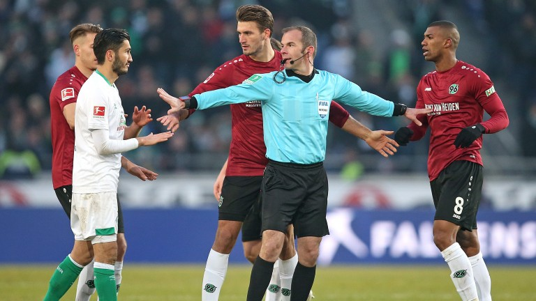 Weserstadion referee Marco Fritz calms matters in a game between Hannover and Werder Bremen