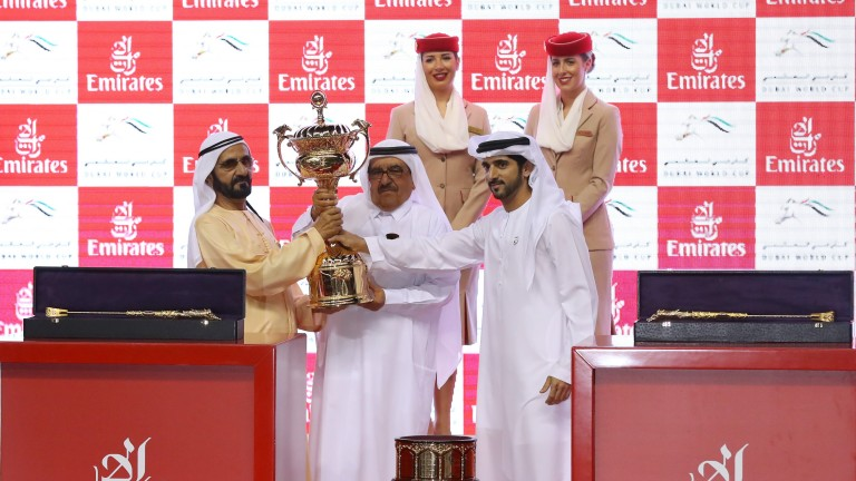 Sheikh Mohammed (left) receives the trophy after Thunder Snow's victory in the Dubai World Cup