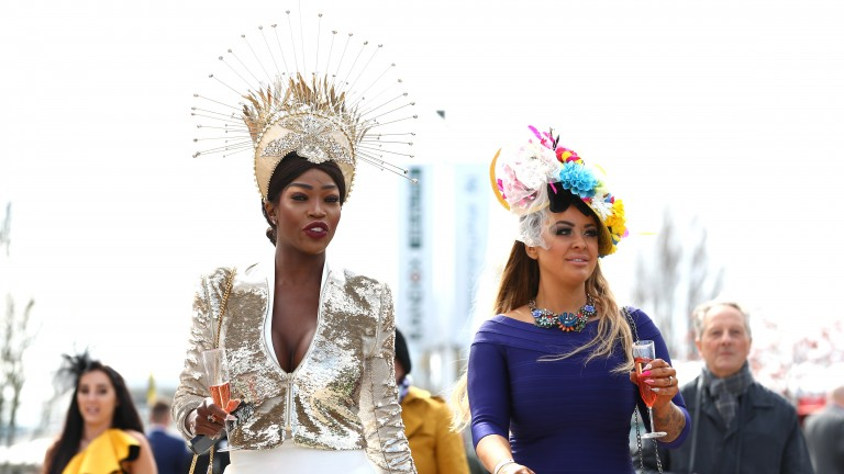 Racegoers enjoy getting dressed up for Ladies' Day at the 2019 Grand National Festival