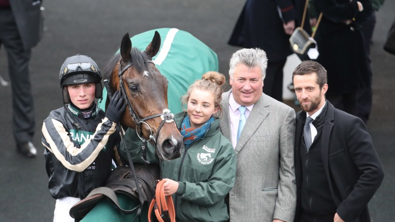 Chris Welch (right) joins trainer Paul Nicholls after victory for McFabulous