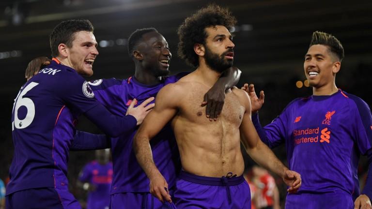 Shirtless Mohamed Salah celebrates his goal for Liverpool