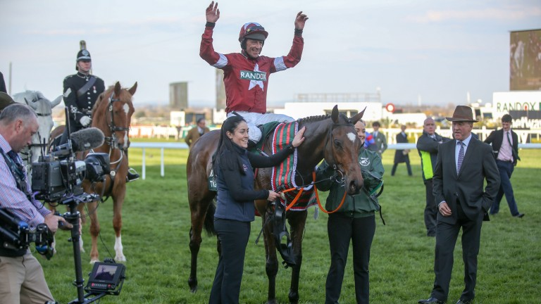 Davy Russell celebrates after winning the Grand National on Tiger Roll on Saturday