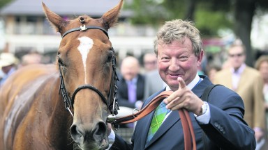 Mark Johnston with his record-breaking winner Poet's Society at York last August