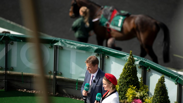 Ed Chamberlin and Francesca Cumani in action at Aintree