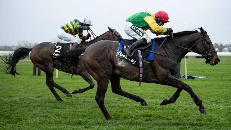 Supasundae and Robbie Power get the better of Buveur D'Air (left) in the Aintree Hurdle
