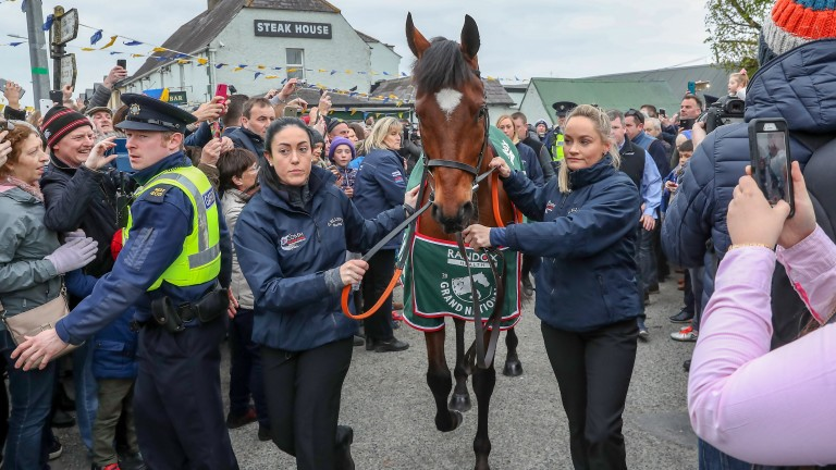 Tiger Roll is paraded through the streets after winning the Grand National