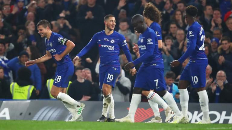 Eden Hazard celebrates his superb opener against West Ham with Chelsea colleagues