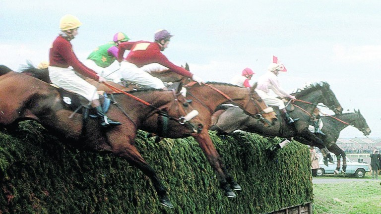 Tough guys: Red Rum and Brian Fletcher (nearest) clear an unmodified Becher's Brook on their way to winning the 1973 Grand National