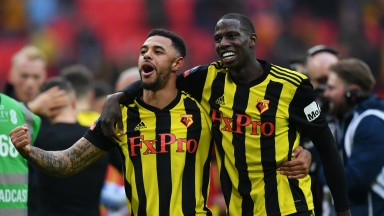 Andre Gray (left) and Abdoulaye Doucoure celebrate Watford's FA Cup semi-final win