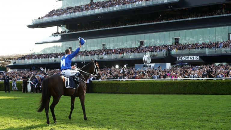 Hugh Bowman salutes the crowd after Winx's Queen Elizabeth Stakes victory