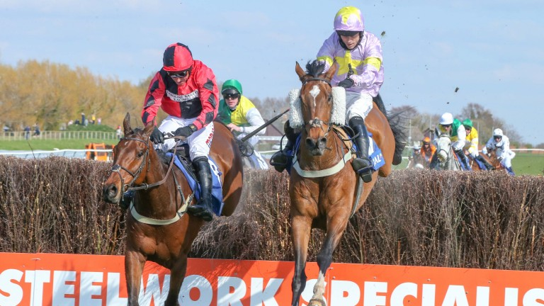 Takingrisks (right) and Crosspark do battle in the Scottish Grand National