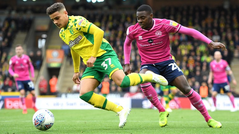 Max Aarons of Norwich is challenged by Bright Osayi-Samuel of Queens Park Rangers