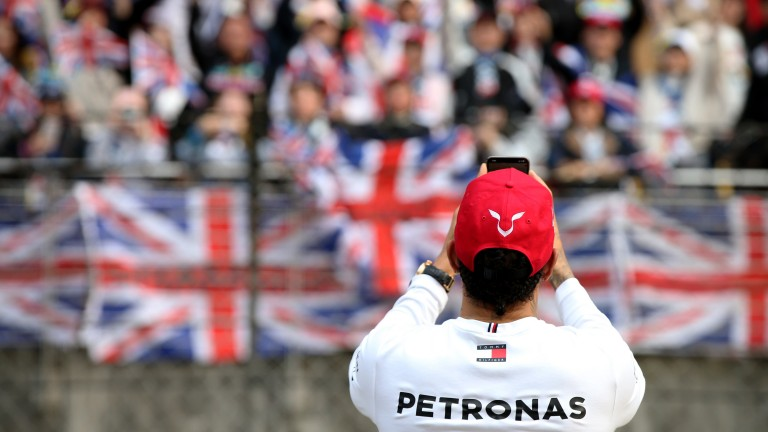 Lewis Hamilton takes a photo of his fans after winning the Chinese Grand Prix
