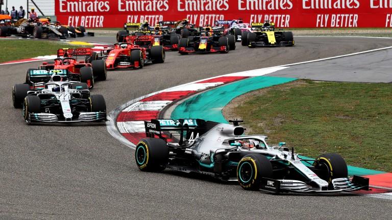 Lewis Hamilton took the lead from Mercedes teammate Valtteri Bottas at the start