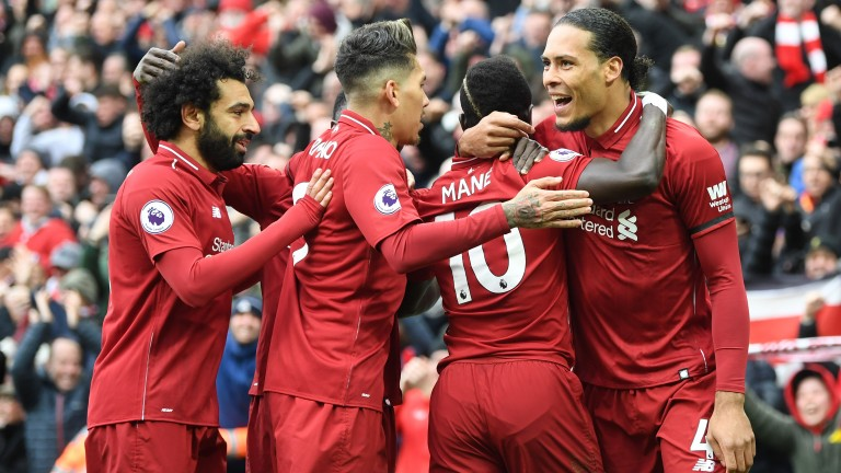 Sadio Mane celebrates with Liverpool teammates after scoring the first goal against Chelsea