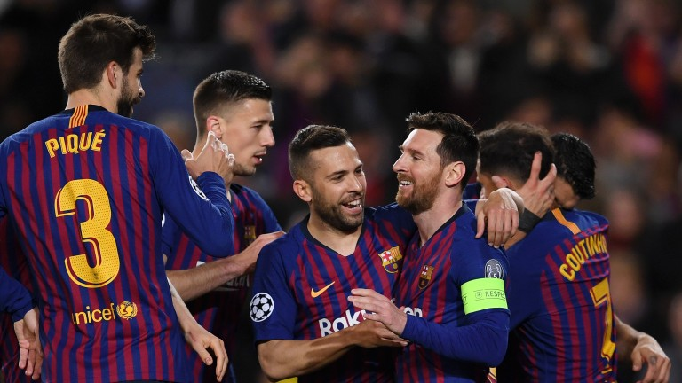 Lionel messi and Barcelona celebrate the first of their five goals at home to Lyon in the last round