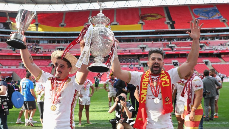 Tony Gigot and Mickael Simon celebrate with the Challenge Cup after Catalans Dragons beat Warrington Wolves at Wembley Stadium