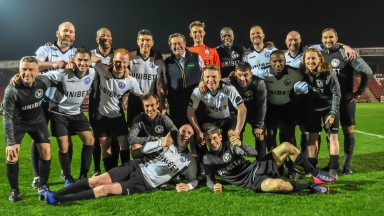 The Unibet Invitation XI line up at Cheltenham Town's stadium on Wednesday night