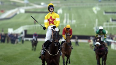 An ecstatic Ruby Walsh celebrates victory in the 2004 Champion Chase on Azertyuiop for Nicholls