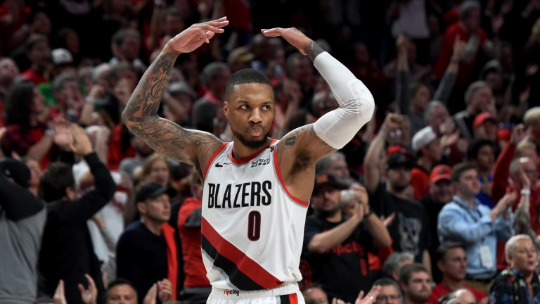 Damian Lillard fires up the Portland crowd during the Trail Blazers' game two win