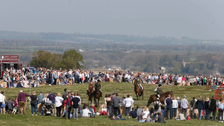 Crowds gather on Low Morr to watch the Rehabilitation of Racehourses parade in Middleham with commentary from Niall Hannity