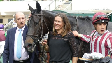Trainer Francois Nicolle and jockey Kevin Nabet flank De Bon Coeur after her success in the Prix Leon Rambaud at Auteuil