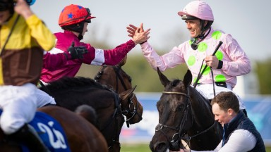 Ruby Walsh celebrates winning the Irish Grand National on Burrows Saint with Rachael Blackmore.FairyhousePhoto: Patrick McCann/Racing Post 22.04.2019