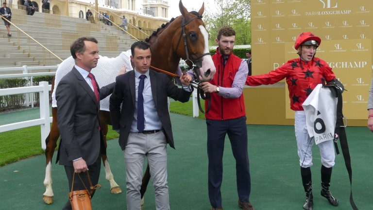 Eagle Hunter flanked by trainer Francis Graffard, travelling head lad Anthony David and jockey Pierre-Charles Boudot