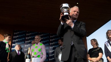 Willie Mullins lifts the Irish Grand National trophy after Burrows Saint's victory.FairyhousePhoto: Patrick McCann/Racing Post 22.04.2019