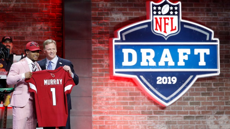 Kyler Murray poses with NFL commissioner Roger Goodell after being announced as the first pick in the first round of the NFL Draft