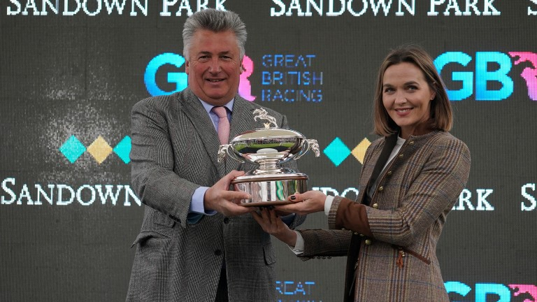 Victoria Pendleton presents trainer Paul Nicholls with his trainers' title trophy