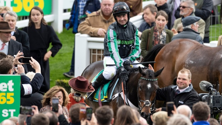 Altior and Nico de Boinville return to the winner's enclosure after winning the Celebration Chase at Sandown
