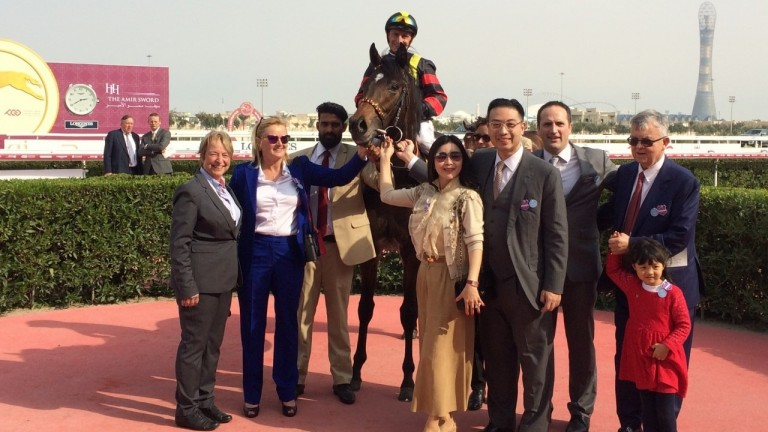 Johnny Hon (third right) with Global Spectrum after the Al Biddah Mile at Doha