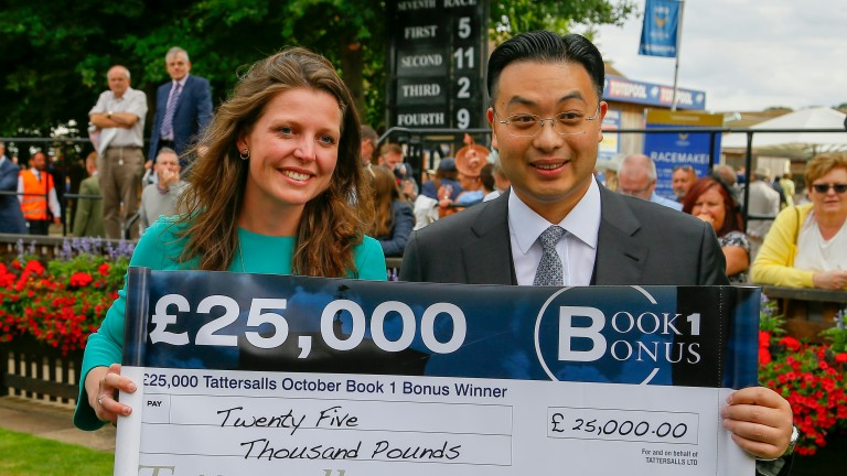 Johnny Hon collects his Book 1 Bonus cheque from Melissa Jordan of Tattersalls