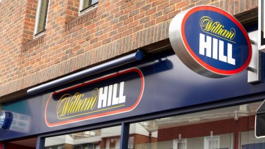 Betting shops. William Hill. Retail shop signs