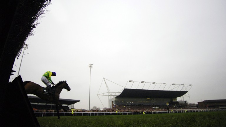 Ruby Walsh and Kauto Star over the last fence before victory in the King George in 2006