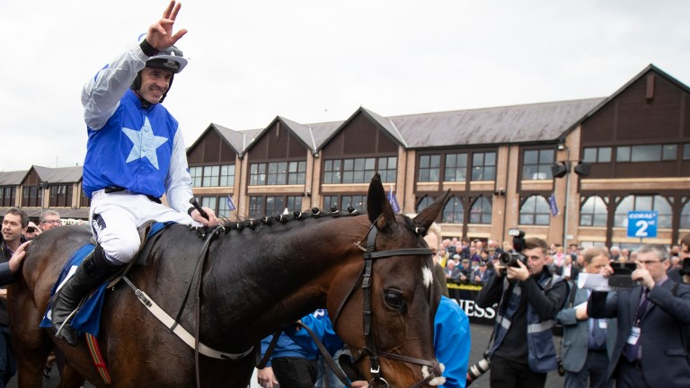 The last salute: Ruby Walsh announced his retirement on dismounting from Kemboy following the pair's success in the Coral Punchestown Gold Cup on Wednesday