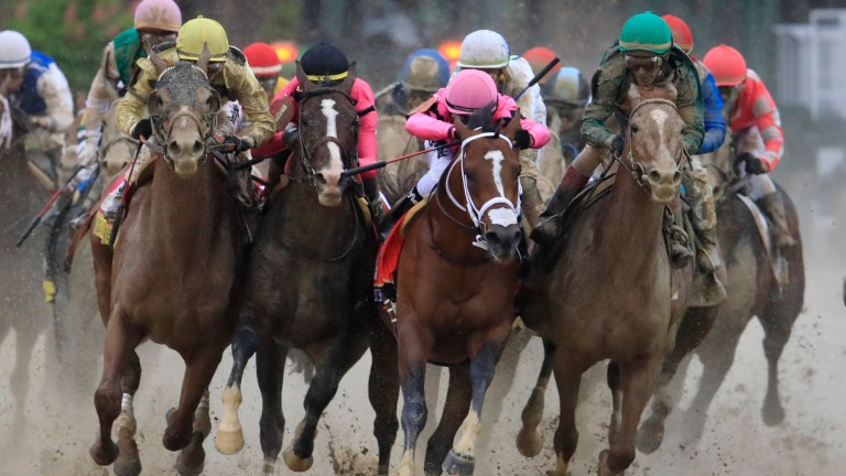 Luis Saez (pink, centre) was suspended for his Kentucky Derby ride