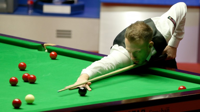 Judd Trump begins his last-16 clash with Dave Gilbert today at the Crucible