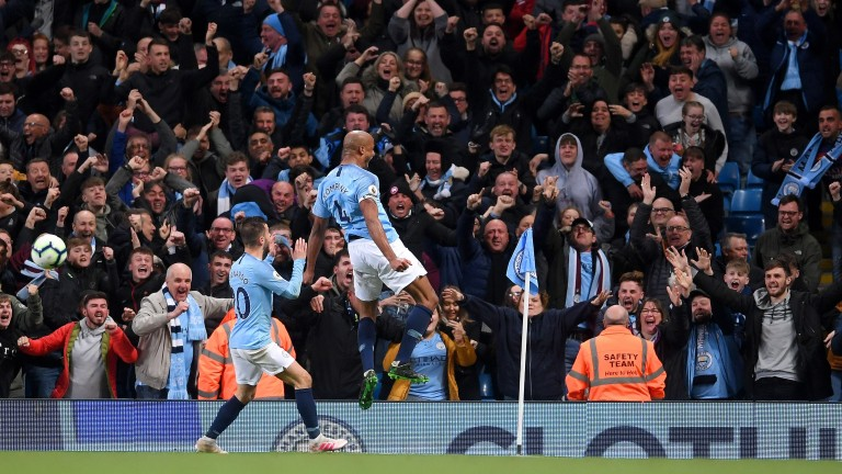 Vincent Kompany celebrates his goal for Man City
