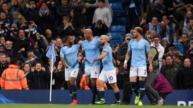 Manchester City teammates help Vincent Kompany celebrate his wonderstrike against Leicester