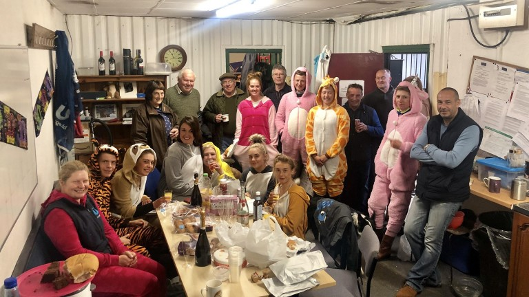 One for all, all for onesies: the Rebecca Menzies team celebrate after a good morning's work
