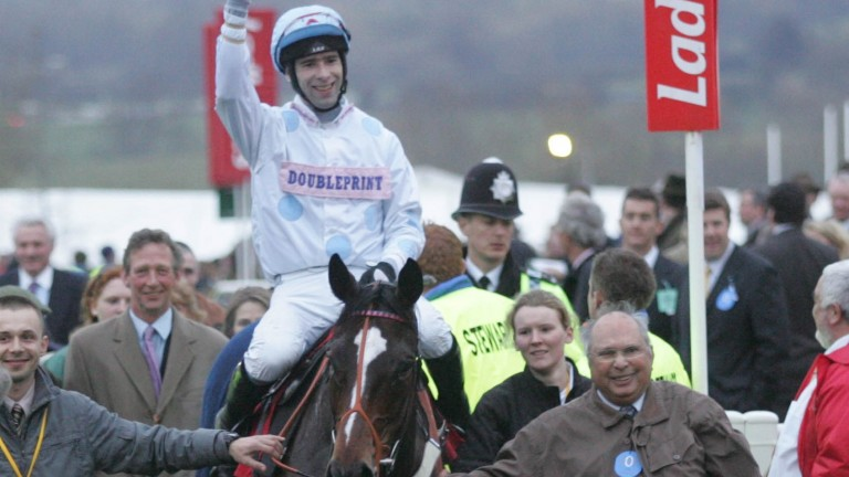 Happier times: David Arbuthnot (left) follows Oscar Park (Tom Doyle) and owner George Ward into the winner's enclosure following their win in the 2007 Pertemps Final at Cheltenham