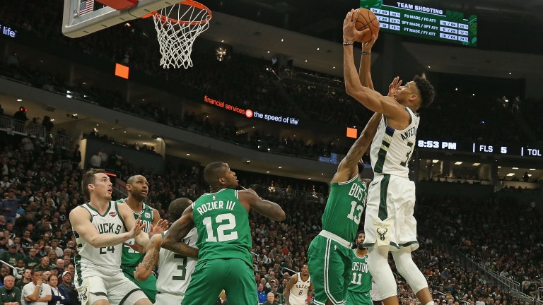 Giannis Antetokounmpo (right) could be rising high for the Milwaukee Bucks against the Toronto Raptors